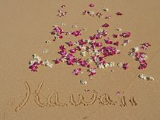 Free Hawaii Written In Sand On Hawaiian Beach Orchids Stock Photography - 16749532