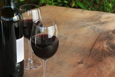 Free Red Wine On Outdoor Wooden Table Stock Images - 16749614