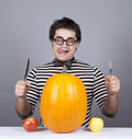 Free The Young Mad Men Try To Eat Apples And Pumpkin. Royalty Free Stock Images - 16755859