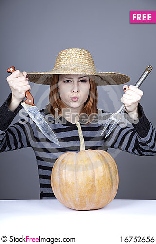 Free Funny Girl In Cap Try To Eat A Pumpkin. Royalty Free Stock Image - 16752656