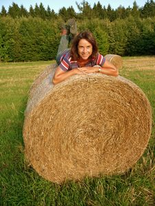 Free Happy Woman On Straw Bale Royalty Free Stock Photos - 16751548