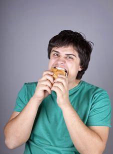 Cute Boy Eating Hamburger. Stock Images