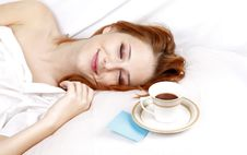 Woman Lying In The Bed Near Cup Of Coffee. Stock Photos