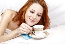 Free Woman Lying In The Bed Near Cup Of Coffee. Royalty Free Stock Photography - 16752127