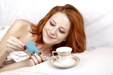 Woman Lying In The Bed Near Cup Of Coffee. Stock Photo