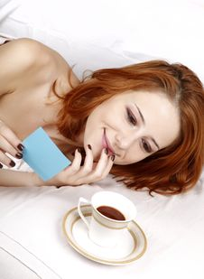 Woman Lying In The Bed Near Cup Of Coffee. Royalty Free Stock Photo