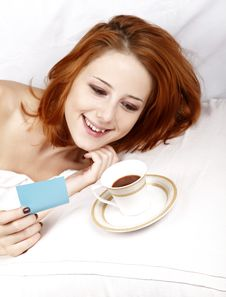 Woman Lying In The Bed Near Cup Of Coffee. Royalty Free Stock Images