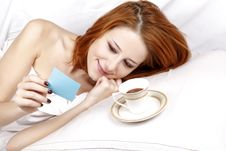 Free Woman Lying In The Bed Near Cup Of Coffee. Royalty Free Stock Image - 16752146