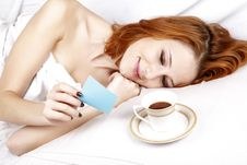 Free Woman Lying In The Bed Near Cup Of Coffee. Stock Photo - 16752150