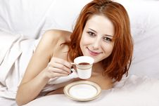 Woman Lying In The Bed Near Cup Of Coffee. Stock Image