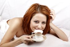 Free Woman Lying In The Bed Near Cup Of Coffee. Royalty Free Stock Photography - 16752177