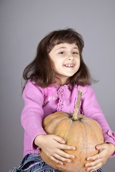 Free Smiling Little Girl With Pumpkin. Royalty Free Stock Images - 16752379