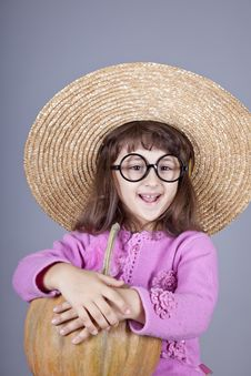 Free Funny Girl In Cap And Glasses Keeping Pumpkin. Royalty Free Stock Photo - 16752415