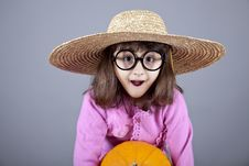 Free Funny Girl In Cap And Glasses Keeping Pumpkin. Royalty Free Stock Photo - 16752455