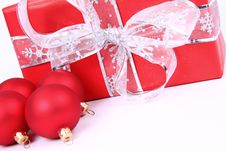 Christmas Balls And A Gift Background Stock Photography