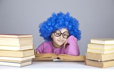 Young Blue-haired Girl With Books. Royalty Free Stock Photos