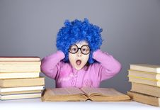 Young Blue-haired Girl With Books. Royalty Free Stock Image