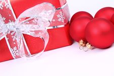 Christmas Balls And Gift Background Stock Photos