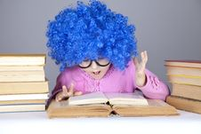Young Blue-haired Girl With Books. Royalty Free Stock Photography