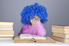 Young Blue-haired Girl With Books. Stock Image