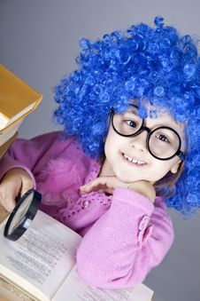 Young Blue-haired Girl With Books. Royalty Free Stock Photo