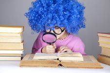 Funny Blue-haired Girl With Loupe And Books. Stock Photo