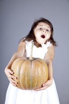 Free Funny Little Girl In Dress Keeping Pumpkin. Royalty Free Stock Photography - 16752607