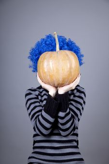 Free Funny Girl With Blue Hair Keeping Pumpkin. Stock Photo - 16752620