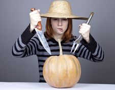 Free Funny Girl In Cap Try To Eat A Pumpkin. Stock Photography - 16752662