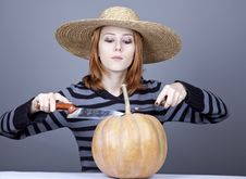 Free Funny Girl In Cap Try To Eat A Pumpkin. Royalty Free Stock Image - 16752676