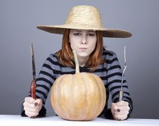 Free Funny Girl In Cap Try To Eat A Pumpkin. Royalty Free Stock Photo - 16752685