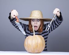 Free Funny Girl In Cap Try To Eat A Pumpkin. Stock Image - 16752701