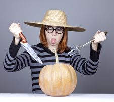 Free Funny Girl In Cap Try To Eat A Pumpkin. Stock Photography - 16752712