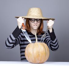Free Funny Girl In Cap Try To Eat A Pumpkin. Royalty Free Stock Images - 16752719