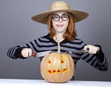 Free Funny Girl In Cap Try To Eat A Pumpkin. Royalty Free Stock Photos - 16752728