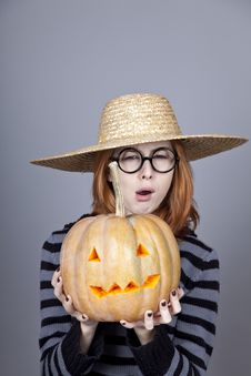 Free Funny Girl In Cap Showing Pumpkin. Stock Images - 16752754