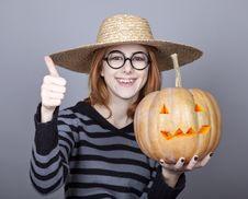 Free Funny Girl In Cap Showing Pumpkin. Stock Photo - 16752810
