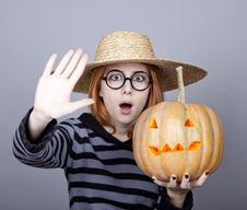 Free Funny Girl In Cap Showing Pumpkin. Stock Photography - 16752822