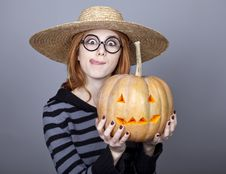 Free Funny Girl In Cap Showing Pumpkin. Royalty Free Stock Photo - 16752835