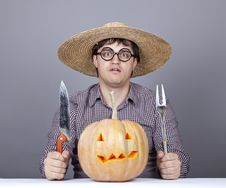 Funny Men Try To Eat A Pumpkin. Stock Images