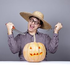 Free Funny Men Try To Eat A Pumpkin. Stock Photo - 16752850