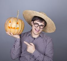 Free Funny Men Try To Eat A Pumpkin. Stock Photography - 16752882
