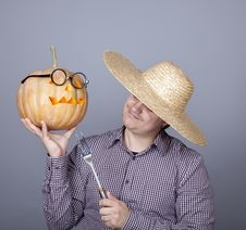 Free Funny Men Try To Eat A Pumpkin. Royalty Free Stock Photo - 16752905