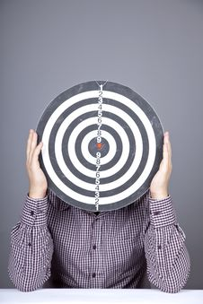 Boy With Dartboard In Place Of Head. Royalty Free Stock Image