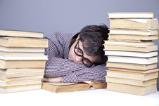 The Young Tired Student With The Books Isolated. Royalty Free Stock Photos