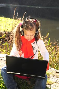 Little Girl With A Laptop Stock Photos