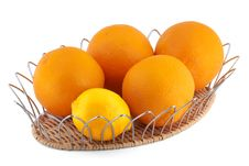 Oranges And A Lemon In A Fruits Basket Royalty Free Stock Photography