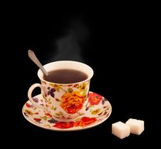A Cup Of Hot Tea With A Sugar Isolated On Black Stock Photo