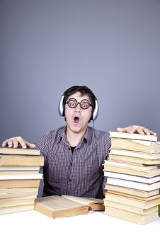 Student With The Books And Headphone Isolated. Stock Photography