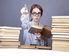Free The Young Teacher In Glasses With Books. Royalty Free Stock Image - 16755796